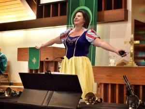 I take no blame for the halo in this picture. And the handbell tables are obscuring the red cowboy boots.