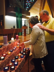 lighting candles to remember